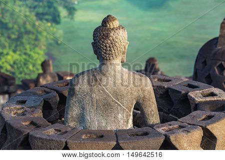 Buddha Statue at Borobudur Temple Ruin in Yogyakarta Java Indonesia.
