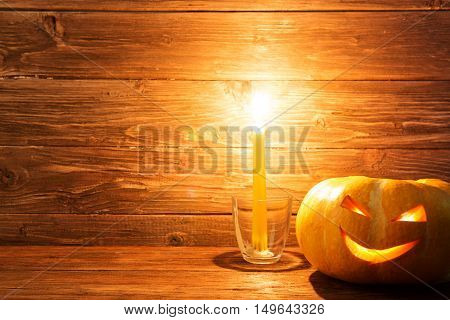 Jack O Lanterns Halloween Pumpkin Face On Wooden Background.