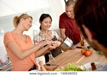 Friends having fun cooking together