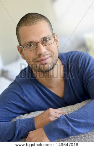 Man with eyeglasses at home relaxing in sofa
