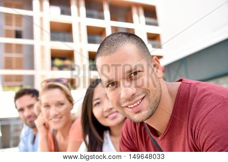 Young multi-racial peole in student city