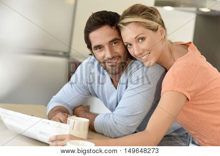 Middle-aged couple relaxing at home
