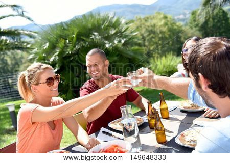 Friends having lunch outside on a sunny day