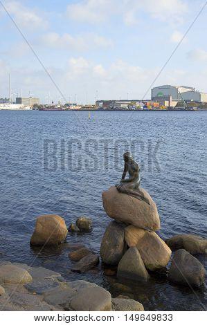 DENMARK - NOVEMBER 03, 2014: View of the sculpture of the little Mermaid - the symbol of Copenhagen. Tourist landmark of the Denmark
