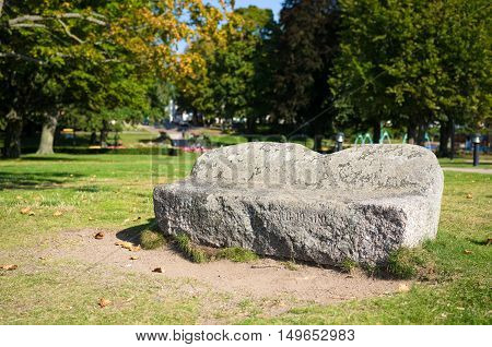 An old stone bench on a sunny day