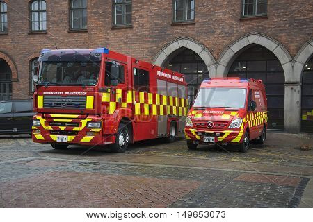 COPENHAGEN, DENMARK - NOVEMBER 01, 2014: Two fire trucks outside at the building of management of the fire Department of Copenhagen