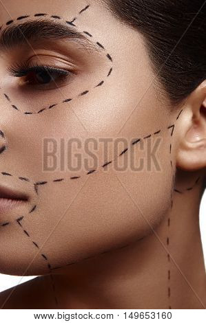 Art Makeup on face of Fashion Beauty Woman. Dashed line on her Skin