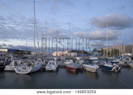TALLINN, ESTONIA - JULY 31, 2015: Parking of small size vessels in the sea port of Tallinn at dusk. Tourist landmark