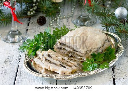 Homemade Meat Chicken Roll With Mushrooms, Onions And Gelatin On The Christmas Table.