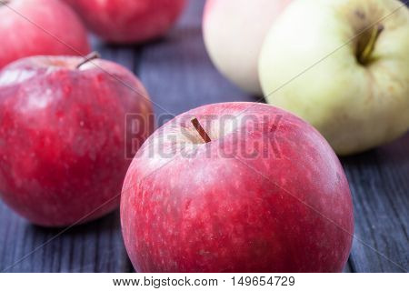 ripe red apples on a table selective focus