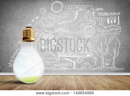 Glowing glass light bulb in room and sketches on wall