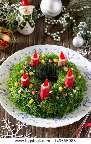 Christmas Salad With Rice, Corn, Cucumber And Crab Sticks. Decorated Advent Wreath And Candles.