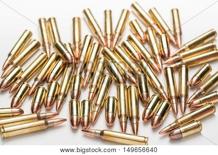 Selective focus ammunition 9mm .223 556 isolated a on white surface