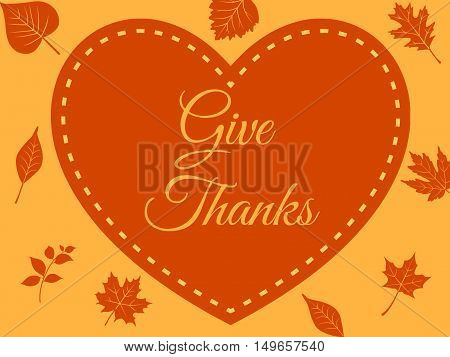 Give thanks handwritten on orange heart, leafy backround