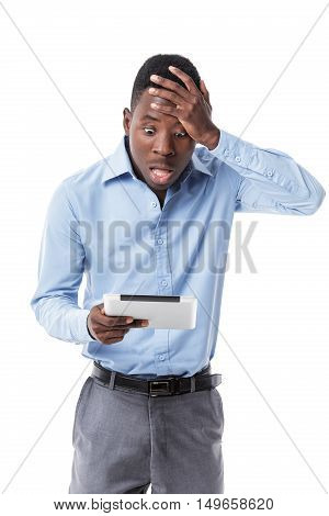shocked African-American businessman saw the news in the tablet on white background