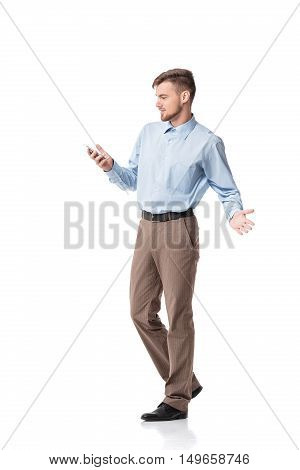 Portrait of  surprised businessman looking at phone, isolated on white background