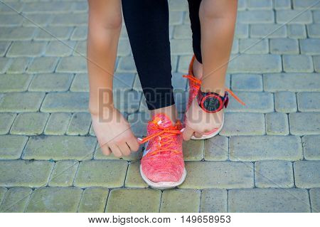 Young Fitness Girl Ties Up Sneakers Laces Preparing For Run