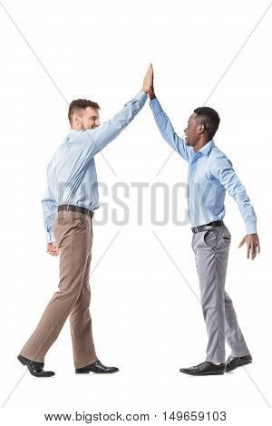 Young business men giving each other a high five isolated on white background