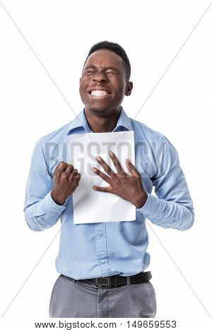 handsome young Afro American businessman  keeping fist up and document screaming with happiness on white background