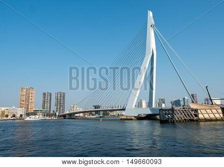ROTTERDAM, NETHERLANDS - 15 SEPT. 2016: View on the Erasmus Bridge, also called The Swan, on the Maas river in Rotterdam. The city has Europe's largest container port