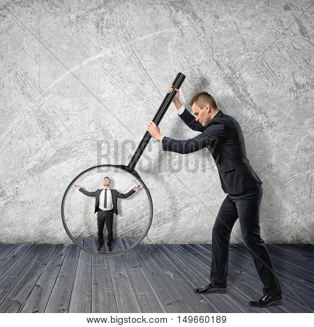 Big businessman enlarging small businessman with magnifying glass. Business staff. Colleagues and coworkers. Subordination and subjection.