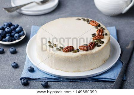 Vegan, raw carrot cake. Grey stone background