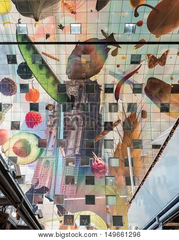 ROTTERDAM, NETHERLANDS - 15 SEPT. 2016: View on colorful and artisctic decoration of the newly built Markthal in Rotterdam. The markthal with shops and stalls is also a residential building.
