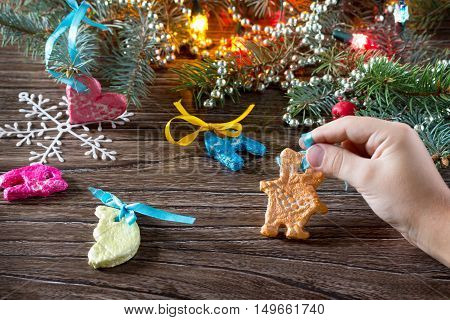 The Child Holds A Garland Of Christmas Decorations From Salt Dough. Children's Art Project, A Craft