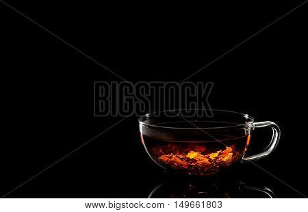 cup of fragrant tea on a black background