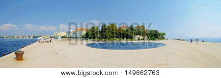 ZADAR CROATIA - SEPTEMBER 14: Panoramic view of the Sea organ and watefront area of Zadar which is a popular landmark for tourists on September 14 2016 in Zadar