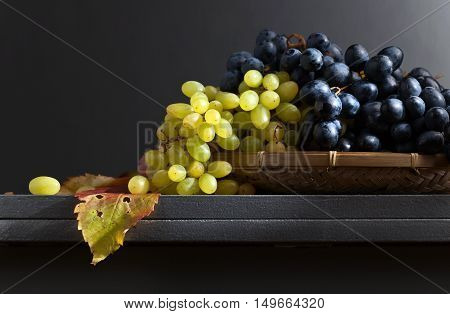 Blue And Green Grapes On A Kitchen Table