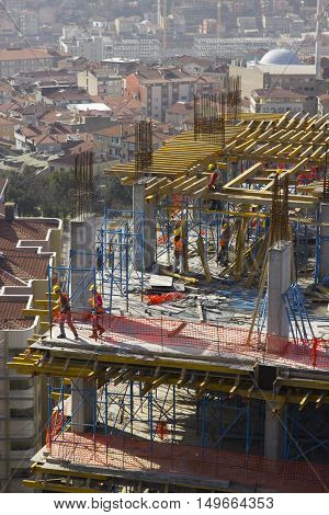Construction site workers working top of the building / ISTANBUL - TURKEY 26 May 2015