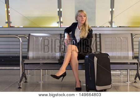 Stylish Woman Waiting At An Airport Terminal