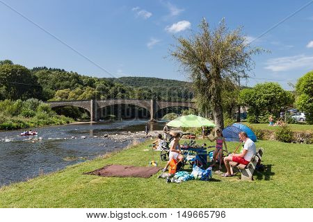 VRESSE-SUR-SEMOIS BELGIUM - AUG 15: Family recreating near the riverside on August 15 2016 at the river Semois Belgium