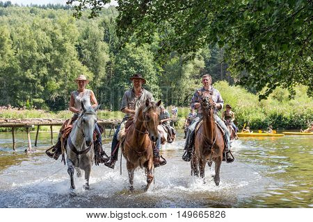 LAFORET BELGIUM - AUG 15: Riders and horses crossing the river Semois on August 15 2016 near Laferet Belgium