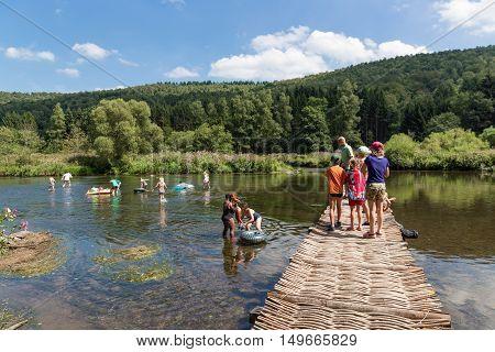 LAFORET BELGIUM - AUG 15: Recreating people near the riverside of the river Semois on August 15 2016 near Laforet Belgium
