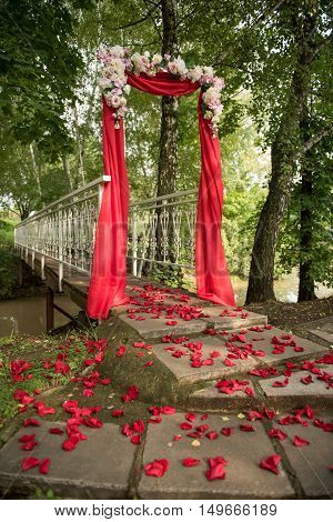 wedding decor flower arch of red color