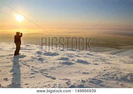 Skier On The Mountain. Looking Into The Distance. Evening