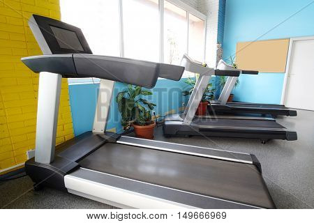 Interior of a fitness hall with treadmill