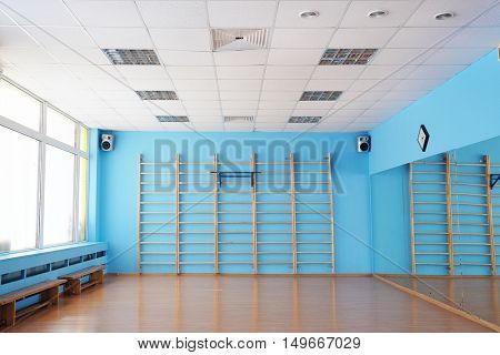 The image of a wall bar in a fitness hall