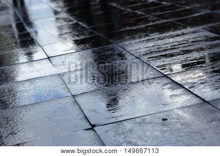 Silhouettes on wet road tiles shallow depth of field, outdoor shoot