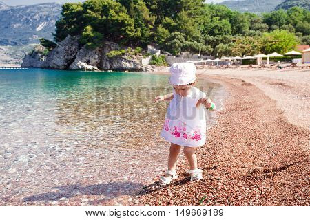 Little Girl First Time On The Beach