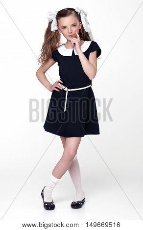 Beautiful cute little school girl emotion on white background