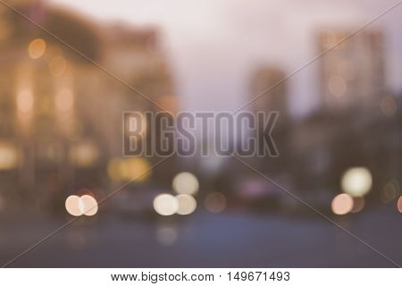 Blurred evening city street lights out of focus background