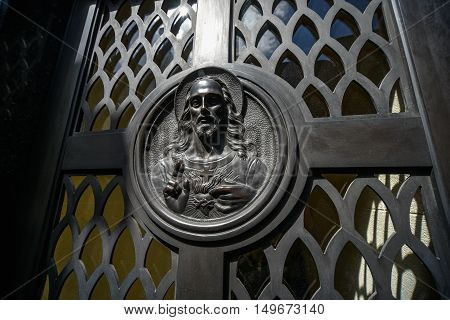 Buenos Aires Argentina - Sept 23 2016: Jesus Сhrist image on a tomb at the La Recoleta Cemetery in Capital Federal.