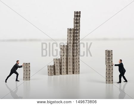 Business person built together a construction with magnets