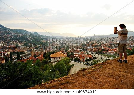 BOSNIA AND HERZEGOVINA SARAJEVO - AUGUST 27: Sarajevo city panoramic shot from a hill at sunset on August 27 2016 in Sarajevo.