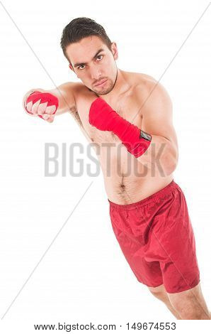 latin martial arts fighter wearing red shorts and wristband punching isolated on white