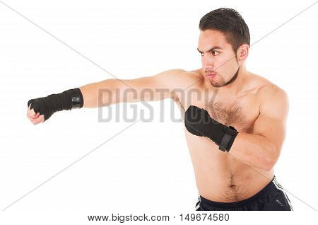 muscular martial arts fighter attacking punching isolated on white