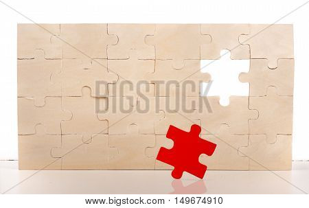 Wood puzzle with a red piece missing